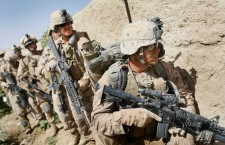 MAIN POSHTEH, AFGHANISTAN  - JULY 02:  U.S. Marines from 2nd Marine Expeditionary Brigade, RCT 2nd Battalion 8th Marines Echo Co. prepare to search a building during the start of Operation Khanjari on July 2, 2009 in Main Poshteh, Afghanistan. The Marines are part of an operation to take areas in the Southern Helmand Province that Taliban fighters are using as a resupply route and to help the local Afghan population prepare for the upcoming presidential elections.  (Photo by Joe Raedle/ Getty Images)