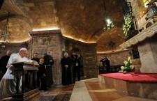 Pope Francis prays at the tomb of St Francis as part of his pastoral visit in Assisi on October 4, 2013. Pope Francis visits Assisi for the first time today to honour the saint whose name he adopted for a papacy aimed at promoting peace and helping the poor, the Vatican said. The pope will attend the feast of St Francis of Assisi (1182-1226) on that day, praying at the tomb of a saint who is widely loved in Italy. AFP PHOTO POOL / CROCCHIONI        (Photo credit should read CROCCHIONI/AFP/Getty Images)