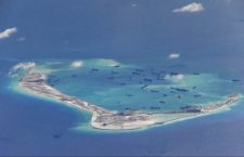 Chinese dredging vessels are purportedly seen in the waters around Mischief Reef in the disputed Spratly Islands in the South China Sea, May 21, 2015.   REUTERS/U.S. Navy