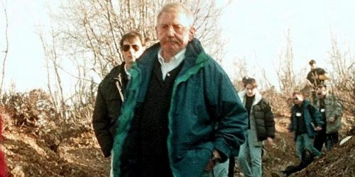 "PRI10-19990116-RACAK, KOSOVO, YUGOSLAVIA: OSCE Kosovo Verification Mission (KVM) chief, US diplomat William Walker, grim-faced passes by the body of a killed ethnic Albanian man, during a KVM investigation visit to the village of Racak (some 25 km south of Pristina), 16 January 1999, where Serbian security forces and Kosovo Liberation Army (KLA) rebels had fightings near here on Friday. The bodies of at least 39 ethnic Albanians, among them a woman and a child, were found deat here on Saturday, with most of them shot in the head and one man decapitated in the massacre. Walker said that the deaths looked ""like executions"". EPA-PHOTO/EPA/ALBAN BUJARI/lg/kr/ow"
