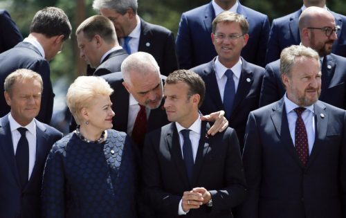 Albania's Prime Minister Edi Rama (C) speaks with France's President Emmanuel Macron (2ndR) and Lithuania's President Dalia Grybauskaite (2ndL) as they pose for a family photo during an EU-Western Balkans Summit in Sofia on May 17, 2018. - European Union leaders meet their Balkan counterparts to hold out the promise of closer links to counter Russian influence, while steering clear of openly offering them membership. (Photo by Darko Vojinovic / POOL / AFP)        (Photo credit should read DARKO VOJINOVIC/AFP/Getty Images)