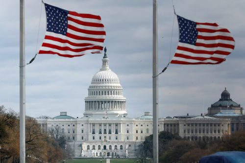 American flags fly on National Mall with U.S. Capitol on background as high-wind weather conditions continue in Washington, U.S. March 2, 2018. REUTERS/Yuri Gripas